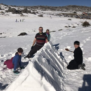 Scouts building snow shelters during the annual Family Snow Trip