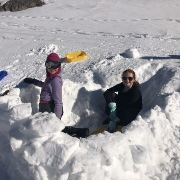 Scouts building igloos during the Annual Ski Trip