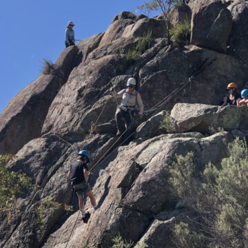 Cubs and Joeys learning to Abseil during the family Alpine Trip
